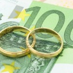 15465634-two-wedding-rings-and-money-as-symbol-f-r-an-expensive-alliance